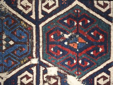 Stacked-row hexagon carpet fragment.